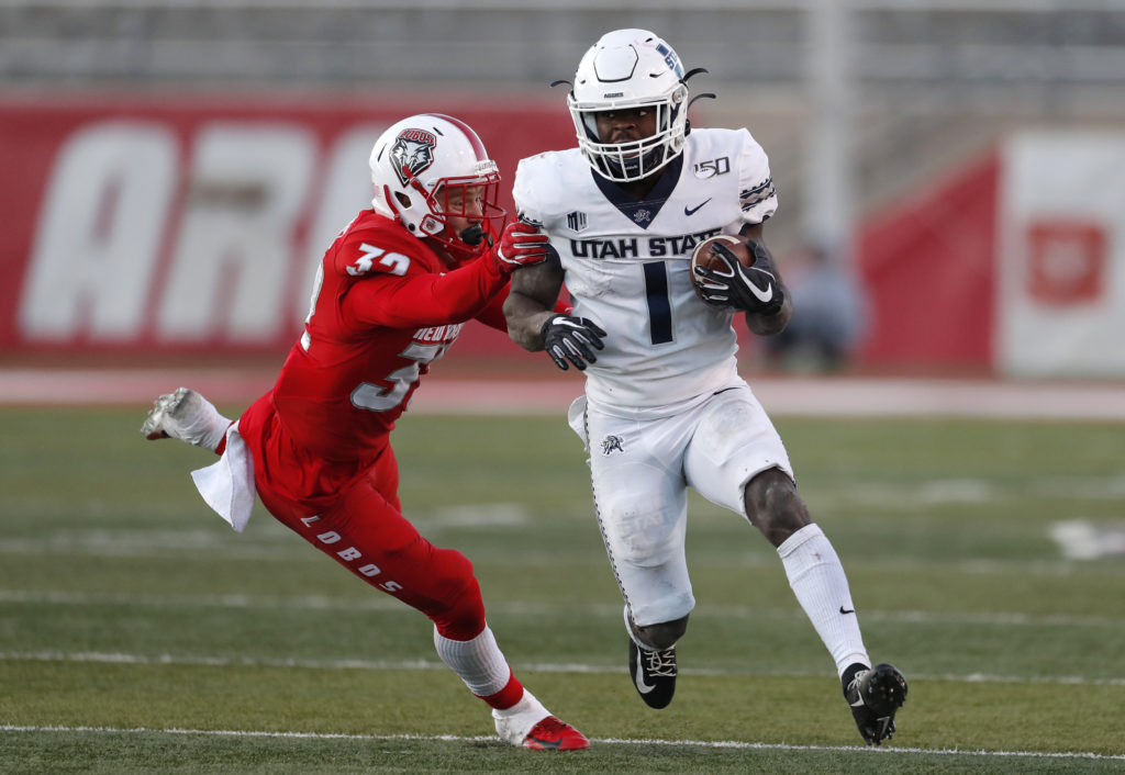 Love leads Utah State to 38-25 victory over New Mexico